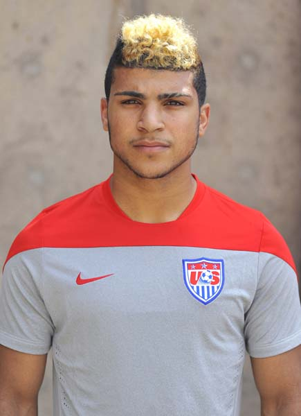 soccer player with blonde curly hair