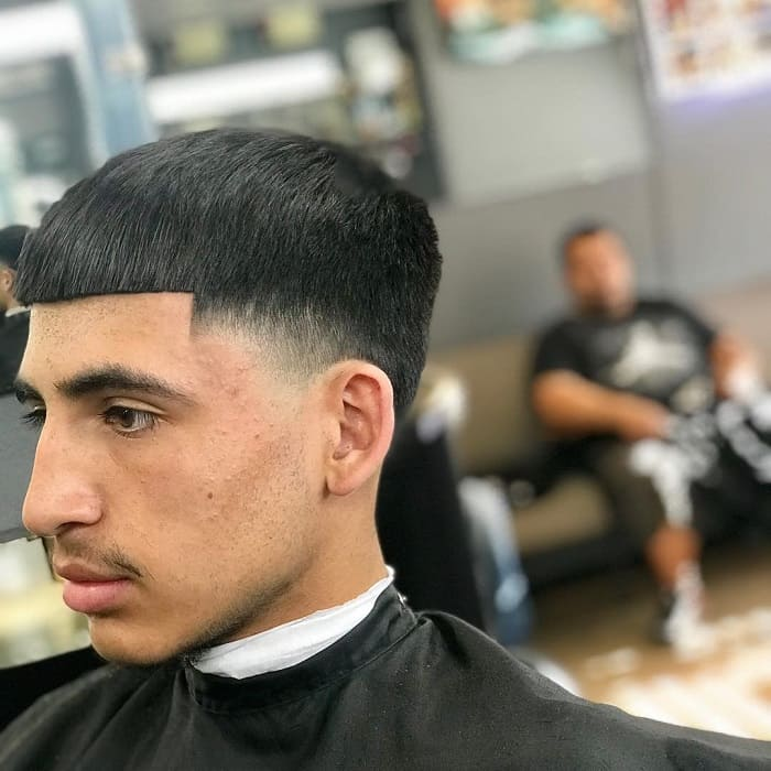 guy with temple fade haircut